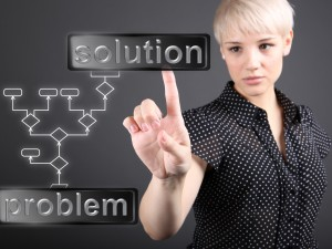 Problem solving concept - business woman touching screen